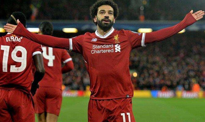 Mohamed Salah celebra un gol con los brazos abiertos hacia el público. Conoce las cuotas del Real Madrid Vs Liverpool.